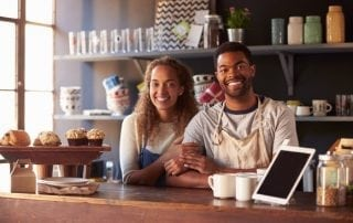 business owning couple in their coffee shop