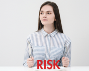 """Red """"Risk"""" with woman with fork and knife at table"""