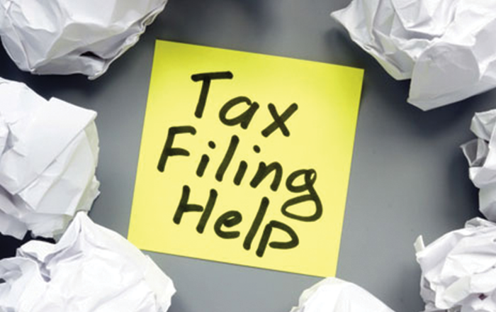 """Sticky Note with """"Tax Filing Help"""" written"""